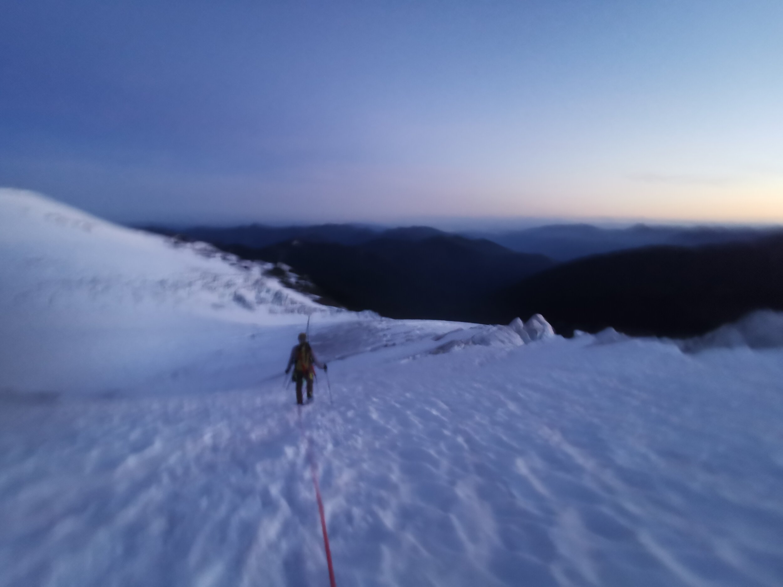 Blurry alpenglow morning shots as we descended and then navigated onto the route (how I usually feel at 4am). Some pretty large crevasses to get over across the main drag